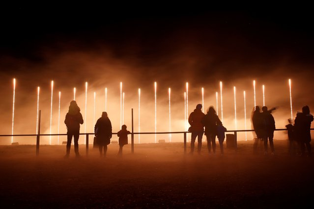 People enjoy The Land of Light show at Longleat House, amid the spread of the coronavirus disease (COVID-19), in Warminster, Wiltshire, Britain on December 12, 2020. Picture taken with a long exposure. (Photo by Paul Childs/Reuters)
