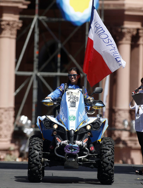 Can-Am rider Paula Galvez of Chile rides her quad during the departure ceremony for Dakar Rally 2015 in front of the Casa Rosada Presidential Palace in Buenos Aires January 3, 2015. (Photo by Marcos Brindicci/Reuters)