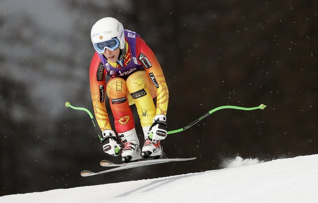 Canada's Larisa Yurkiw is airborne as she clears a gate to finish second in the Ladies' World Cup Downhill skiing race in Cortina D'Ampezzo January 16, 2015. (Photo by Max Rossi/Reuters)