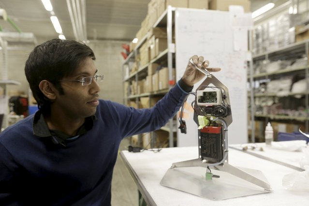 Estonia based startup Welmenni co-founder and CEO Deepak Solanki  adjusts Li-Wi transceiver in Maardu, Estonia, December 17, 2015. Li-Fi is similar to widely used Wi-Fi data transmission technology, but it uses light to transmit data. One of the main advantages of this technology is data transmission worth of velocity of light, which is even 100 times faster than Wi-Fi. (Photo by Ints Kalnins/Reuters)