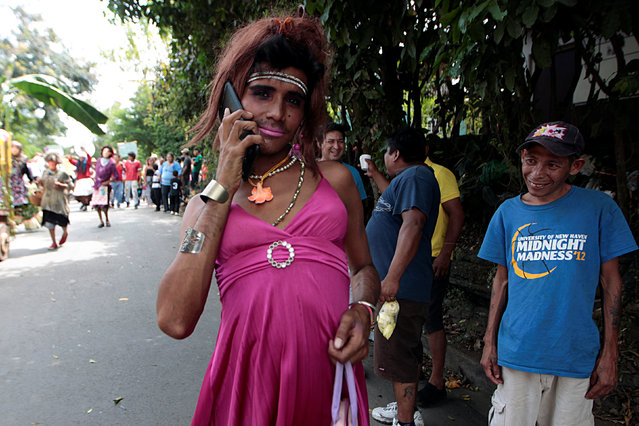 A man dressed as a woman takes part in festivities in honour of patron saint San Jeronimo in Masaya city, Nicaragua November 20, 2016. (Photo by Oswaldo Rivas/Reuters)
