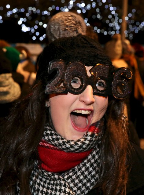 Jessica Taylor watches fireworks during the Hogmanay celebrations in Edinburgh, Scotland, December 31, 2015. (Photo by Russell Cheyne/Reuters)