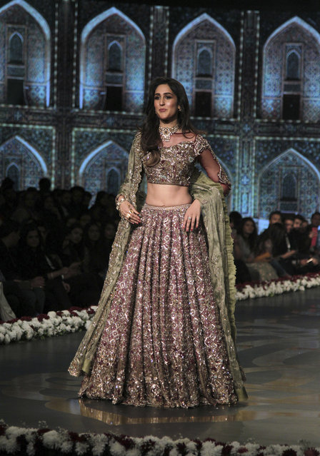 A model presents a creation by designer Faiza Saqlain during Bridal Couture Week 2016 in Lahore, Pakistan, Sunday, November 27, 2016. (Photo by K.M. Chaudary/AP Photo)