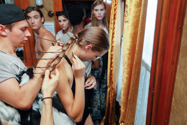 Assistants prepare models backstage by Ukrainian designer Jean Gritsfeldt during the Ukrainian Fashion Week on the railway station in Kiev, Ukraine, 02 September 2018. (Photo by Sergey Dolzhenko/EPA/EFE)