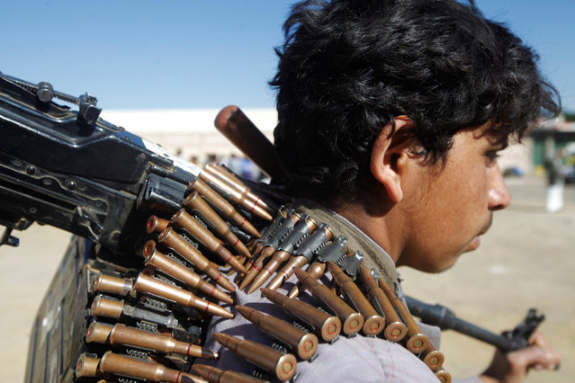 A Houthi rebel holds the barrel of a machine gun he carries during a rally held to mobilize fighters for battles against government forces, in Sanaa, Yemen December 1, 2016. (Photo by Mohamed al-Sayaghi/Reuters)