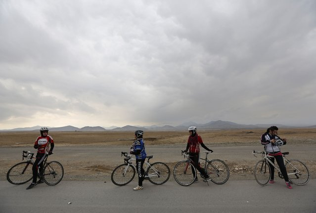 Malika Yousufi (R), Masooma Alizada (2nd R), Frozan Rasooli (3rd R) and Zahra Alizada (L), members of Afghanistan's Women's National Cycling Team take a break during a exercise on outskirts of Kabul February 20, 2015. (Photo by Mohammad Ismail/Reuters)