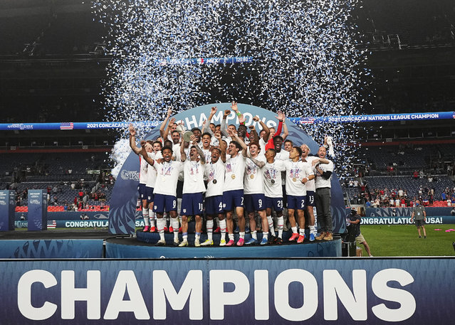 The United States celebrates a 3-2 win against Mexico in extra time in the CONCACAF Nations League championship soccer match, Sunday, June 6, 2021, in Denver. (Photo by Jack Dempsey/AP Photo)
