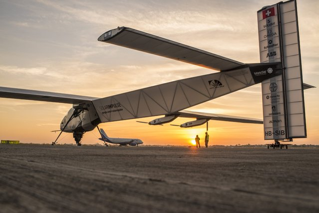 A handout picture provided by Solar Impulse on 18 March 2015 shows the Swiss solar-powered plane Solar Impulse 2, HB-SIB, taking off with Swiss explorer Andre Borshberg on board for the third leg Ahmedabad to Varanasi, of the Round-The-World, in Ahmedabad, India, 18 March 2015. Swiss explorers Bertrand Piccard and Andre Borschberg attempt to circumnavigate the world flying with an aircraft, with a 72 metres wingspan, powered only by solar energy without a drop of fuel. (Photo by EPA/Solar Impulse)