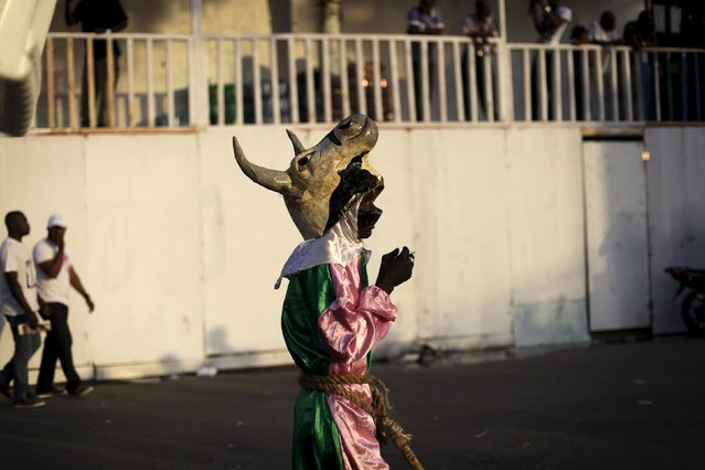 A reveller wearing a papier mache mask representing a cow takes part in the Carnival 2016 parade in Port-au-Prince, Haiti, February 8, 2016. (Photo by Andres Martinez Casares/Reuters)