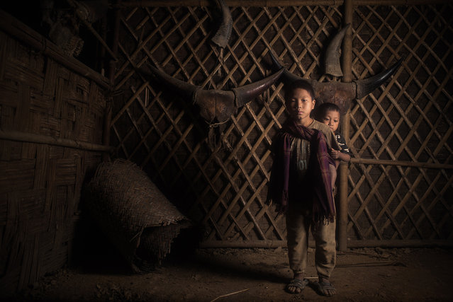 """""""The sons of the Angh of Nyahnyu"""". The remote konyak village of Nyahnyu is located in Nagaland (India) near the border with Myanmar. Each village has an Angh (king of chief) and the succession is determined by blood line. (Photo and caption by Sergio Carbajo (Spain)/2014 Sony World Photography Awards)"""