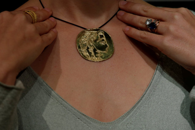 A gold medallion from a set of 28 by Pablo Picasso, estimated between  $449,000 and $513,000 by Sotheby's, is shown at a preview by the auction house in Hong Kong, China January 13, 2017. (Photo by Bobby Yip/Reuters)