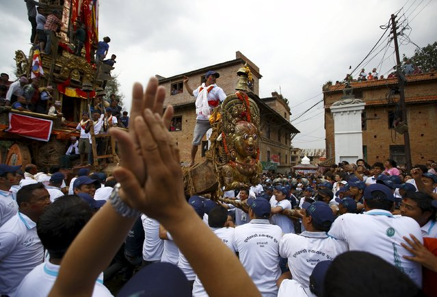 Devotees pull the chariot of Rato Machhindranath during the chariot festival at Bungamati in Lalitpur April 22, 2015. (Photo by Navesh Chitrakar/Reuters)