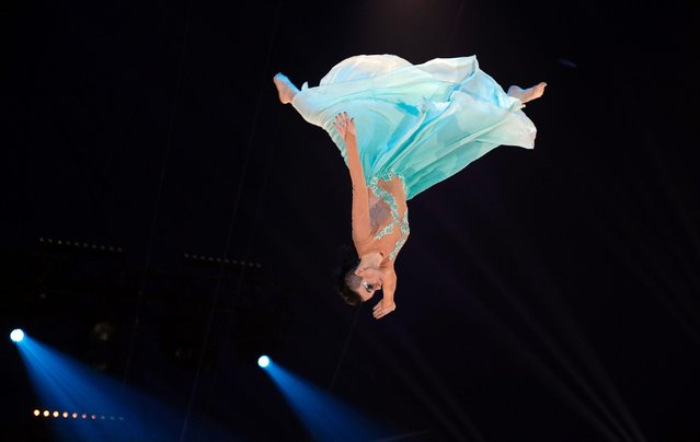"""Artist of the """"Skokov troop"""" performs during the gala of the 41 st Monte- Carlo International Circus Festival in Monaco on January 25, 2017. (Photo by Eric Gaillard/AFP Photo)"""