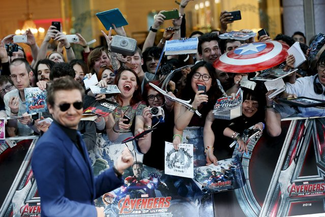 "Fans react as cast member Jeremy Renner poses at the european premiere of ""Avengers: Age of Ultron"" at Westfield shopping centre, Shepherds Bush, London April 21, 2015. (Photo by Stefan Wermuth/Reuters)"