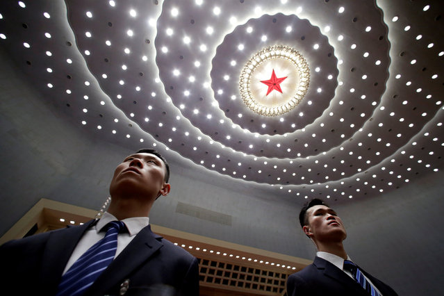 Security personnel stand at their positions inside the Great Hall of the People at the end of the opening session of the Chinese People's Political Consultative Conference (CPPCC) in Beijing, China March 3, 2019. (Photo by Jason Lee/Reuters)