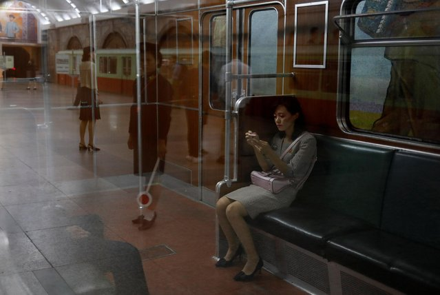 A woman sits in a train at a subway station in Pyongyang, North Korea, September 11, 2018. (Photo by Danish Siddiqui/Reuters)