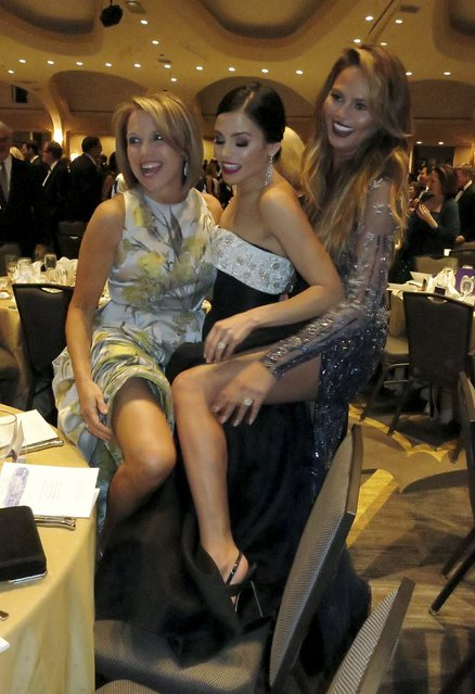 Yahoo Global News Anchor Katie Couric (L), actress Jenna Dewan-Tatum (C) and supermodel Chrissy Teigen (R) pose for a picture for one of their friends as they attend the 2015 White House Correspondents' Association Dinner in Washington April 25, 2015. (Photo by Jim Bourg/Reuters)