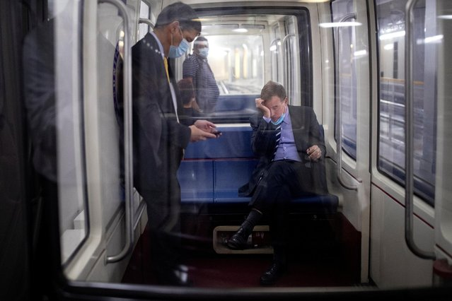 U.S. Senator Mark Warner (D-VA) rubs his eyes while riding the Senate Subway following a vote on Capitol Hill in Washington, U.S., September 29, 2021. (Photo by Tom Brenner/Reuters)