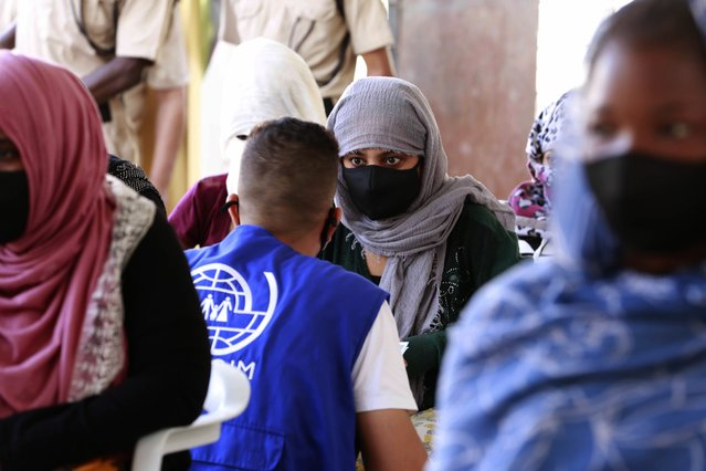 A vaccination campaign against the coronavirus is underway at a Tripoli shelter for migrants, organized jointly by the Libyan center for disease control and the International Organization for Migration. in Tripoli, Libya, Wednesday October 6, 2021. (Photo by Yousef Murad/AP Photo)
