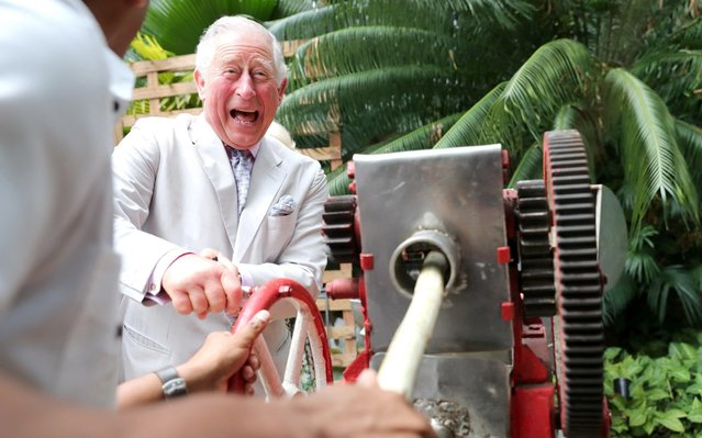 Prince Charles, Prince of Wales grinds sugar cane during a visit to a paladar called Habanera, a privately owned restaurant on March 27, 2019 in Havana, Cuba. Their Royal Highnesses have made history by becoming the first members of the royal family to visit Cuba in an official capacity. (Photo by Chris Jackson/Getty Images)