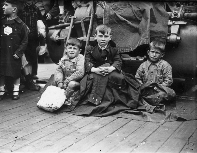 Three young orphans from Bilbao arrive at Southampton aboard the liner Habana, 23rd May 1937. They, and over 4,000 other Basque children, will be housed in Britain until the end of the Spanish Civil War, when they can return to their country. (Photo by E. Dean/Topical Press Agency/Getty Images)