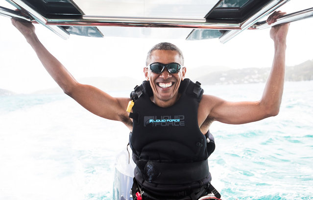 Former U.S. President Barack Obama sits on a boat during a kite surfing outing with British businessman Richard Branson during his holiday on Branson's Moskito island, in the British Virgin Islands, in a picture handed out by Virgin on February 7, 2017. (Photo by Jack Brockway/Reuters/Virgin)