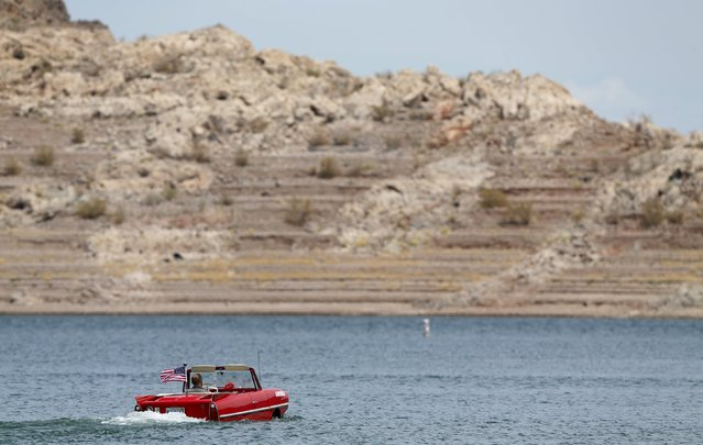 James Spears takes his 1964 German built Amphicar for a drive on Lake Mead in Nevada May 6, 2015. Its a journey many drivers dream of, rather than travelling round a lake simply driving through it. But for James Spears it may be time to make the most of the waters in Lake Mead in Nevada, as water levels are plunging as California struggles to cope with a fourthsuccessive year of droughts. (Photo by Mike Blake/Reuters)