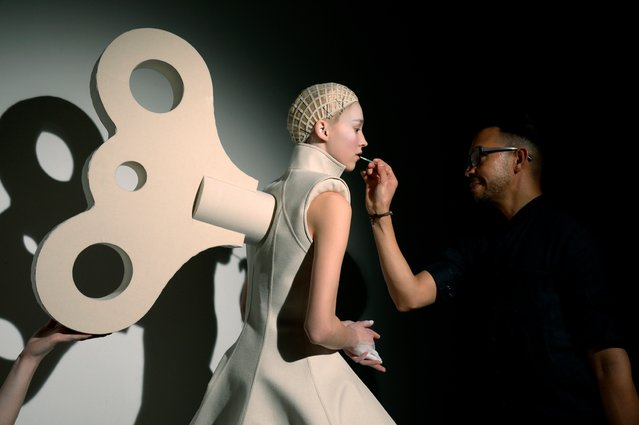 """In the book's introduction, Vogue's Suzy Menkes writes: """"Backstage is another story. It is more about invention than perfection … the best way to plant flowers in someone's hair can suddenly seem like the most important task in the world"""". Here: Gareth Pugh, Autumn/Winter 2014. (Photo by Matt Lever)"""