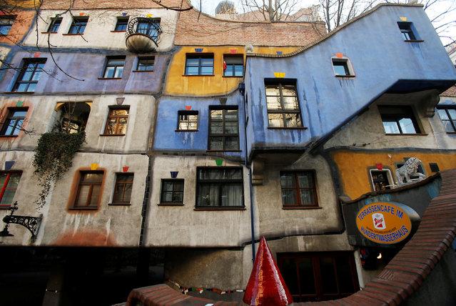 "The Hundertwasser House landmark, an apartment house designed by artist and architect Friedensreich Hundertwasser, with the ""Terrassencafe im Hundertwasserhaus"" is seen in Vienna, Austria, February 15, 2017. (Photo by Heinz-Peter Bader/Reuters)"