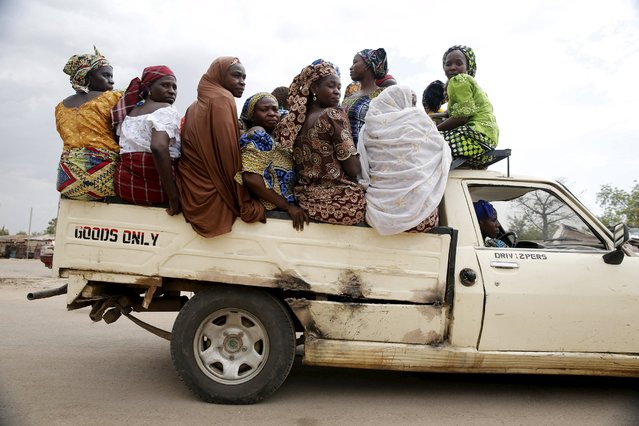 Women travel in the back of a truck in the town of Mararaba, after the Nigerian military recaptured it from Boko Haram, in Adamawa state May 10, 2015. (Photo by Akintunde Akinleye/Reuters)