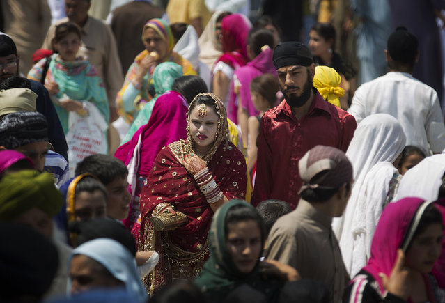 "Sikh pilgrims attend a religious festival in Hasan Abdal near Islamabad in Pakistan, Tuesday, April 14, 2015. Pilgrims arrived from neighboring India and other countries to attend the religious festival ""Besakhi"" at a shrine of Gurdwara Punja Sahib, the second most sacred place for Sikhs. (Photo by B. K. Bangash/AP Photo)"