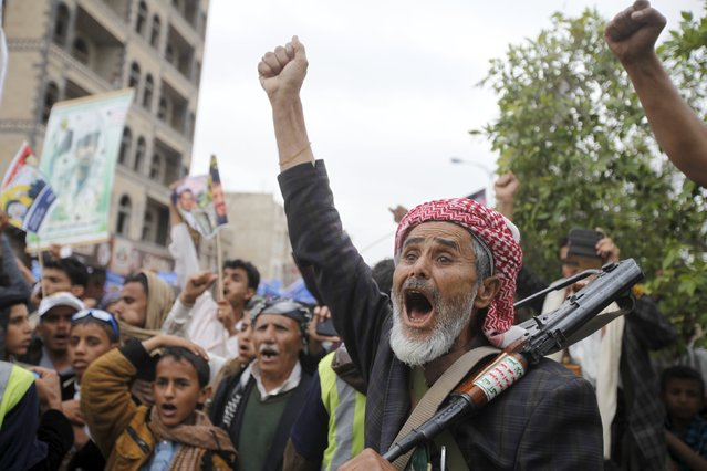 A Houthi militant shouts slogans during a rally against U.S. support to Saudi-led air strikes, in Yemen's capital Sanaa, April 15, 2016. (Photo by Mohamed al-Sayaghi/Reuters)