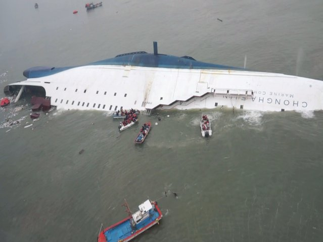 """South Korean ferry """"Sewol"""" is seen sinking in the sea off Jindo April 16, 2014, in this picture provided by Korea Coast Guard and released by Yonhap. Almost 300 people were missing after a ferry sank off South Korea on Wednesday, the coastguard said, in what could be the country's biggest peacetime disaster in nearly 20 years. (Photo by Reuters/Yonhap/Korea Coast Guard)"""