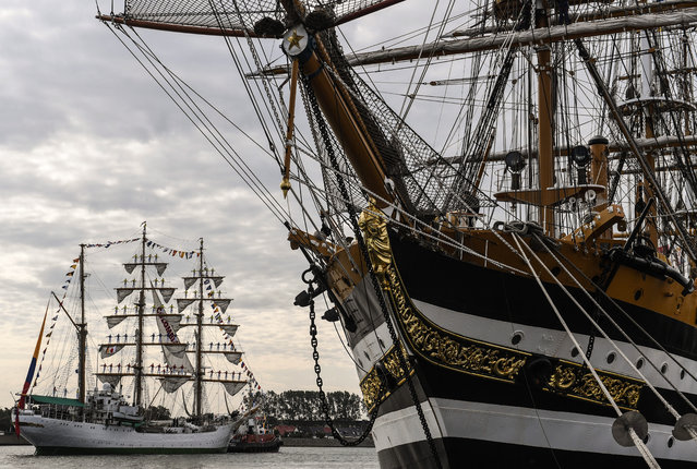 Columbian tall ship Gloria ship (L) pass by Italian Amerigo Vespucci tall ship during the Hanse sail maritime festival, Rostock-Warnemuende, Germany, 08 August 2019. The 29th Hanse Sail maritime festival runs from 08 to 11 August 2019. (Photo by Filip Singer/EPA/EFE)