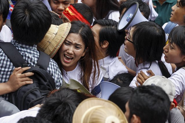 Student protesters and policemen push each other as the students try to pass a police line during a protest against military representatives in parliament who have been appointed by the military commander-in-chief and who occupy a mandatory 25 percent of parliamentary seats, in Yangon June 30, 2015. (Photo by Soe Zeya Tun/Reuters)