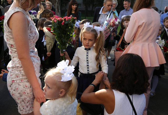 A Belarusian first grade girl gets ready for a welcoming ceremony on the first day of school, which marks the traditional start of the academic year, in Minsk, Belarus, 02 September 2019. The start of a new academic year in Belarus, officially called Day of Knowledge, is a festive day for all school and university students in the country. (Photo by Tatyana Zenkovich/EPA/EFE)