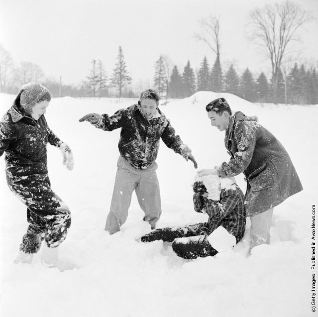 1950: Students who have come to enjoy the winter sports on offer at Tilton School, New Hampshire, involved in a snowball fight