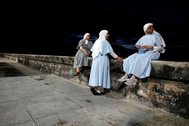 Nuns sit at the sea front in Havana, Cuba, July 10, 2019. (Photo by Alexandre Meneghini/Reuters)