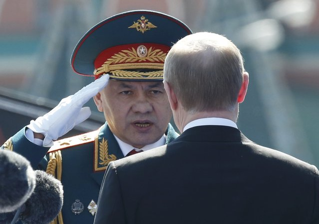 Russian President Vladimir Putin (R) and Defence Minister Sergei Shoigu attend the Victory Day parade, marking the 71st anniversary of the victory over Nazi Germany in World War Two, at Red Square in Moscow, Russia, May 9, 2016. (Photo by Grigory Dukor/Reuters)
