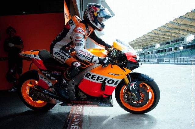 Dani Pedrosa of Spain  and Repsol Honda Team  starts from box during the third day of MotoGP testing at Sepang Circuit