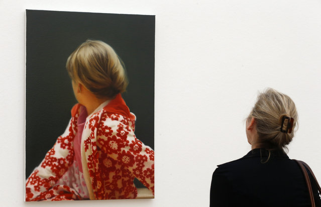 "A woman looks at the oil on canvas painting ""Betty"" from 1988 by German artist Gerhard Richter during a media preview of the exhibition ""Gerhard Richter"" at the Fondation Beyeler in Riehen near Basel May 16, 2014. The exhibition will be open to the public from May 18 to September 7. (Photo by Arnd Wiegmann/Reuters)"