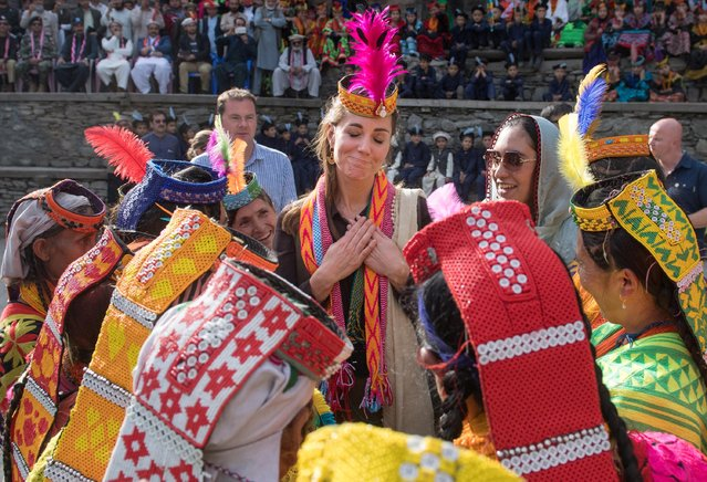 Catherine, Duchess of Cambridge visits a settlement of the Kalash people in Chitral, Pakistan, October 16, 2019. Catherine and her husband Prince William visited a settlement of the Kalash people, a small indigenous group living in the Chitral region where they met with young people and wore colorful local scarves and headwear while being treated to song and dance, during a five-day visit to the South Asian nation. (Photo by Samir Hussein/Pool via Reuters)