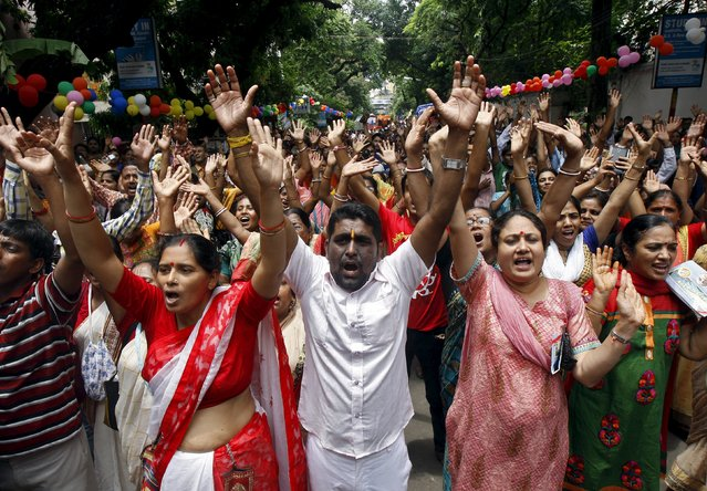 Hindu devotees raise their hands and shout religious slogans during the annual Rath Yatra, or chariot procession, in Kolkata, India, July 18, 2015. (Photo by Rupak De Chowdhuri/Reuters)