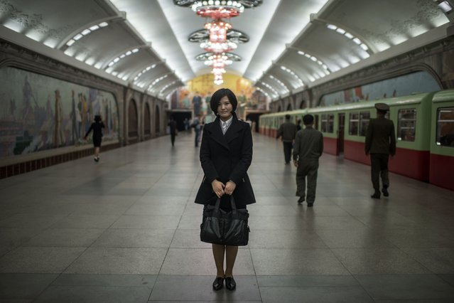 In a photo taken on April 10, 2017 student Cha So-Yon (18) poses for a portrait in a subway station of the Pyongyang metro. (Photo by Ed Jones/AFP Photo)