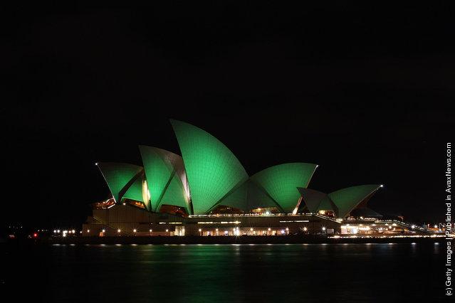 The Sydney Opera House is illuminated green on March 17, 2012 in Sydney, Australia