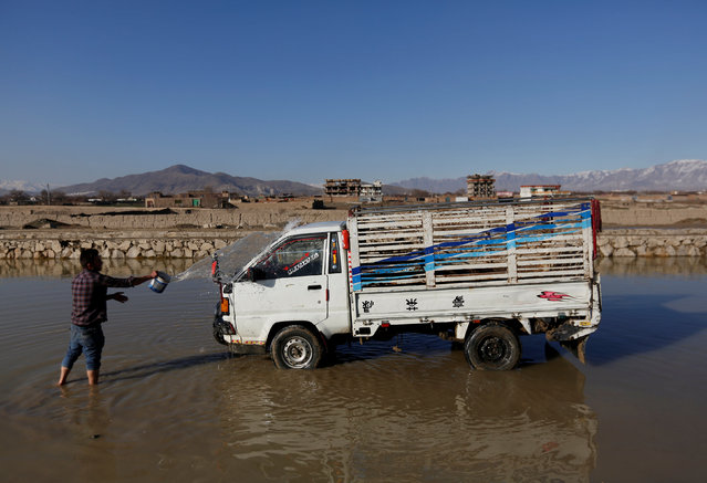 An Afghan man washes his truck with rainwater in Kabul, Afghanistan February 20, 2017. (Photo by Mohammad Ismail/Reuters)