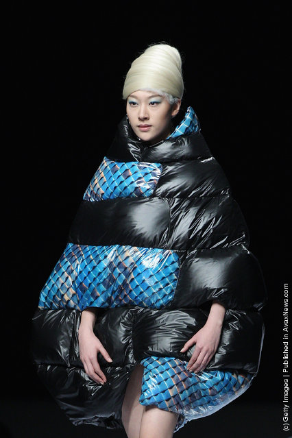 A model showcases designs on the catwalk during OudiFu Collection A/W 2012-2013 of China Fashion Week