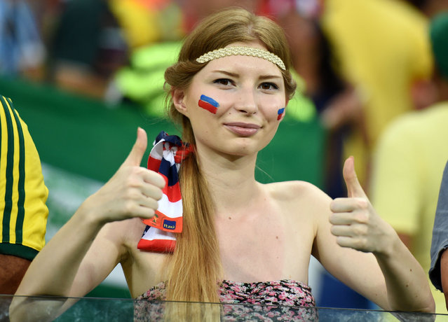 A Russian fan;  Russia v South Korea, 2014 FIFA World Cup football match, Group H, Arena Pantanal Stadium, Cuiaba, Brazil, 17 June 2014. (Photo by Liu Dawei/Rex Features)