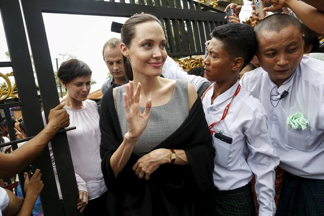 Myanmar pro-democracy leader Aung San Suu Kyi (not pictured) and UNHCR special envoy Angelina Jolie Pitt leave after visiting a hostel for female factory workers in the Hlaingtaryar Industrial Zone in Yangon August 1, 2015. (Photo by Soe Zeya Tun/Reuters)