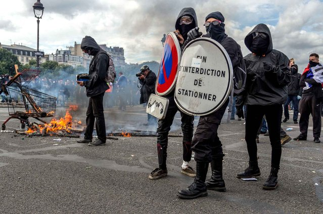 Masked youths face off with French police and gendarmes during a demonstration in Paris as part of nationwide protests against plans to reform French labour laws, France, June 14, 2016. (Photo by Willi Effenberger/Pacific Press/SIPA Press)